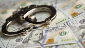 dollars and handcuff